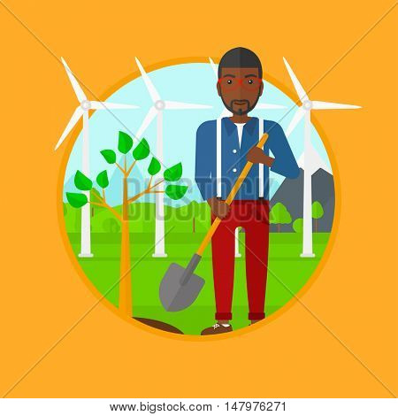 An african-american young man standing with shovel near newly planted tree. Man planting tree on a background of wind turbines. Vector flat design illustration in the circle isolated on background.