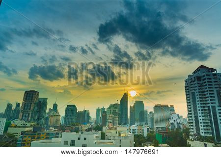 Sunshine morning time of Bangkok city. Bangkok is the capital and the capital city of Thailand. Cityscape with white cloud and blue sky in a sunshine day.
