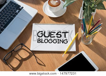 GUEST BLOGGING businessman work hard and use computer