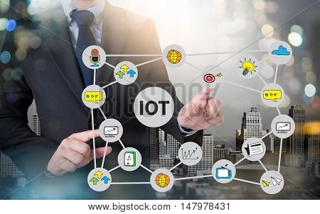 IOT business man hand working and internet of things (IoT) word diagram as concept and businessman working with modern technology poster