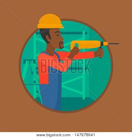 An african-american worker drilling a hole in the wall. Young man in overalls and hard hat working with hammer drill indoors. Vector flat design illustration in the circle isolated on background.