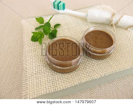 Homemade toothpaste from coconut oil, healing clay powder and peppermint oil