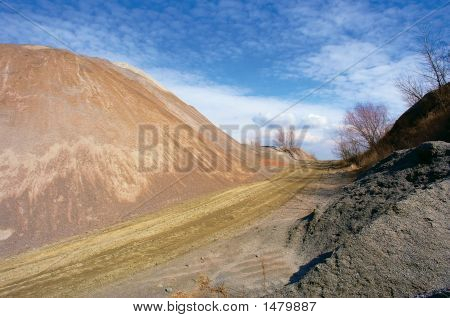 Artificial Stone Hill And Road To Clouds