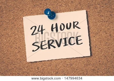 24 hour service note pin on the bulletin board