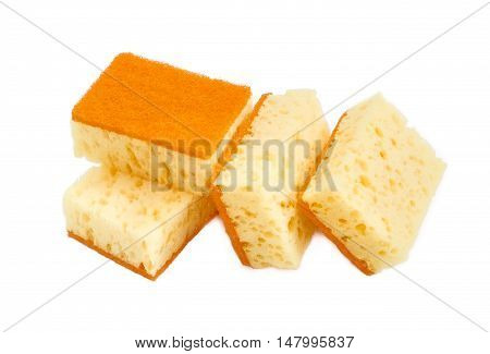 Several yellow synthetic cleaning sponges with layer for more intense scrubbing on a light background