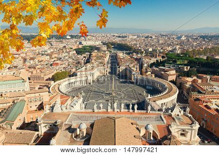 Saint Peter's Square in Vatican and panoranic view of the city frome above at fall day, Rome, Italy