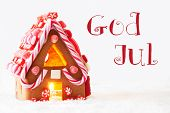 Gingerbread House In Snowy Scenery As Christmas Decoration With White Background. Candlelight For Romantic Atmosphere. Swedish Text God Jul Means Merry Christmas poster