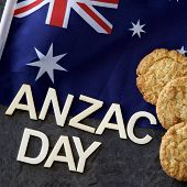 Anzac Day signage with the Australian flag and Anzac biscuits. poster