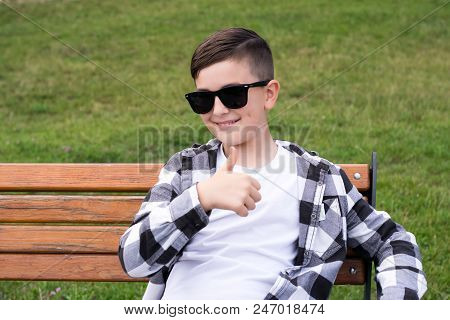 Portrait Of Cheerful Teenager Smiling And Showing Good Symbol Sign With Thumbs Up. Joyous Teenager I