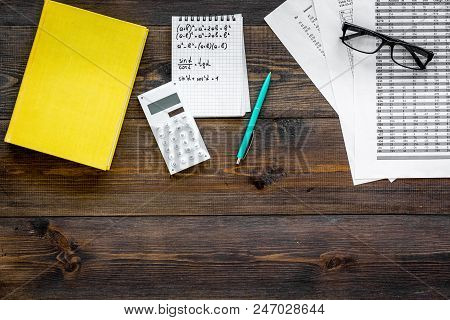 Math Homework. Math Textbook Or Tutorial Near Sheet With Numbers, Countes, Calculator, Notebook With