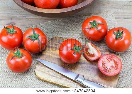 Closeup Fresh Ripe Tomatoes On Wood Background