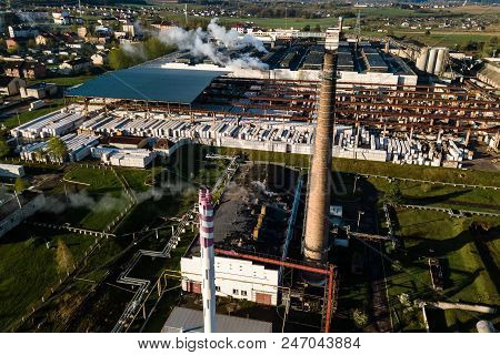 Aerial view of modern large industrial factory with smokestack, industrial area. Concept of air pollution and industrial ecology poster