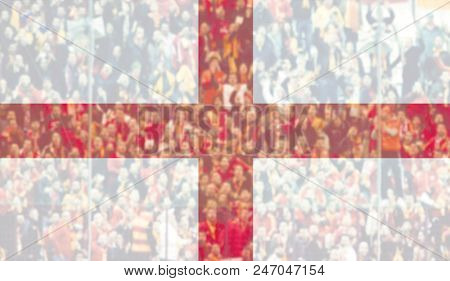 football fans supporting England - crowd in stadium with raised hands against England flag