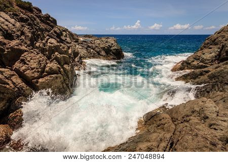 Tide in a small rocky cove on an island in BVI