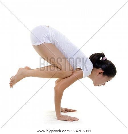 Woman in yoga, Crane Posture (Bakasana), on white background