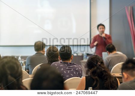 Rear View Of Audience Listening The Specker In Front Of The Meeting Room Or Seminar Room, Business S