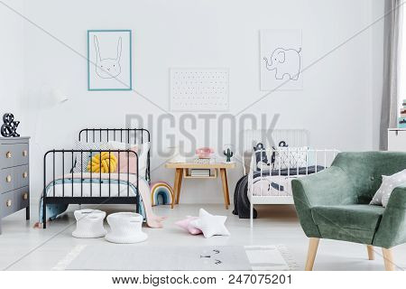 Bright Scandinavian Style Bedroom Interior With Two Metal Frame Kid's Beds, One White, One Black, An