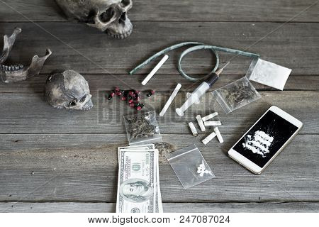 Heroin And Drug Paraphernalia Are Placed On Old Wood, The Concept Of Crime And Drug Addiction. 26 Ju