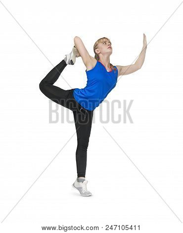 Beautiful Girl Doing Exercises On A White Background.. Gymnast Standing On One Leg. Girl Athlete Blo