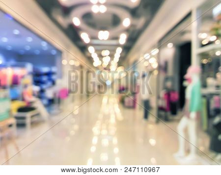 Blurred Clothing Shops With Mannequins At The Storefront In Shopping Mall