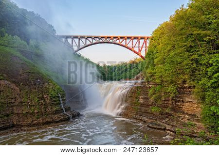 Upper Falls Arched Bridge At Letchworth State Park New York Just After Sunrise