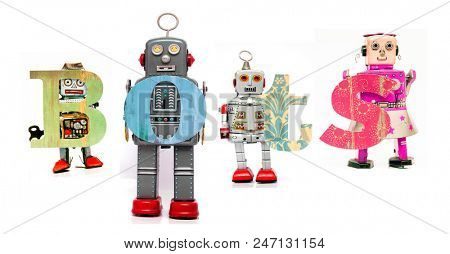 retro tin robot toys hold up the word  BOTS isolated on white
