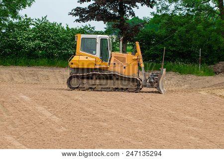 Crawler bulldozer. Lateral view of a crawler bulldozer. poster