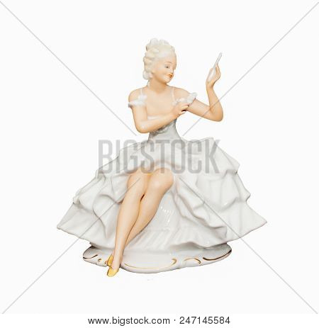 Porcelain figurine of a girl isolated on white background
