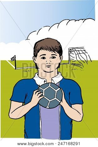 Young Football Player.  Football Player Child Holding Ball In Front Of Football Field.