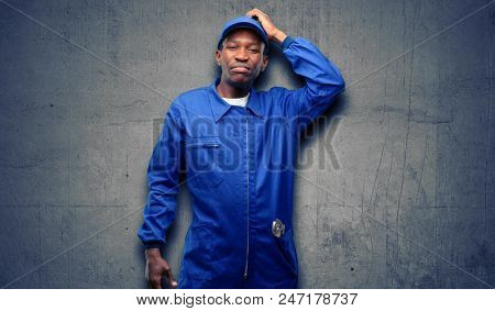 African black plumber man doubt expression, confuse and wonder concept, uncertain future