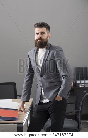Confident Businessman At Working Place. Bearded Man In Casual Suit In Office. Man With Beard And Mus