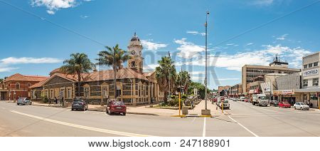 Ladysmith, South Africa - March 21, 2018: A Street Scene, With The Historic Town Hall And Cannons Fr