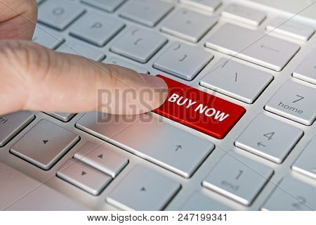 Computer Notebook Keyboard With Buy Key - Technology Background. Buy Now Inscriptions On The Grey Si