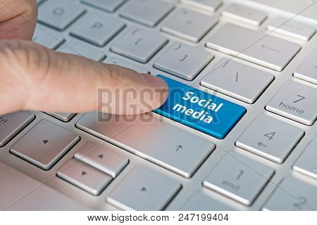 Social Media Keyboard Button. Inscriptions On The Grey Silver Keyboard Button Close Up