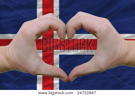 Heart And Love Gesture Showed By Hands Over Flag Of Iceland Background