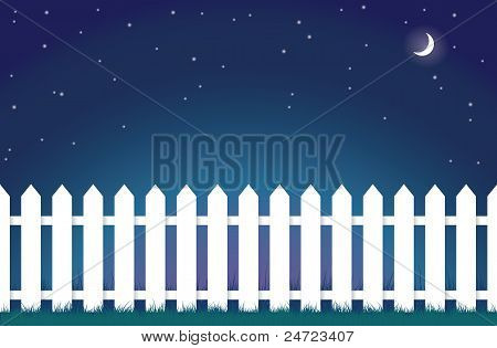 white picket fence at night