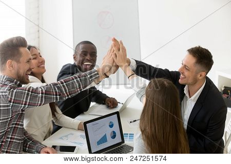 Excited Diverse Millennial Group Giving High Five Celebrating Online Business Win Or Shared Goal Ach