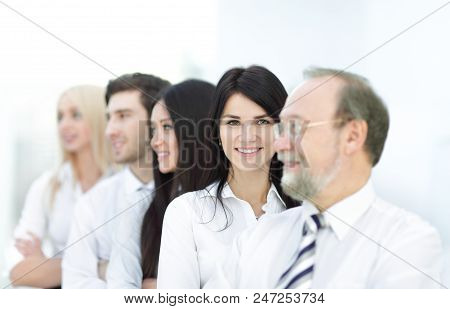 Close-up Portrait Of Executive Business People Standing In A Row At Office And Looking At The Camera