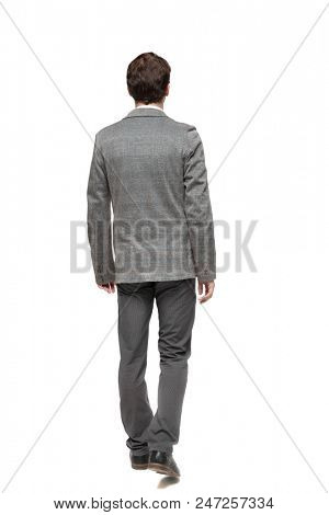 back view of walking business man. going young guy in gray suit. Rear view people collection. backside view of person. Isolated over white background. Young businessman passing by