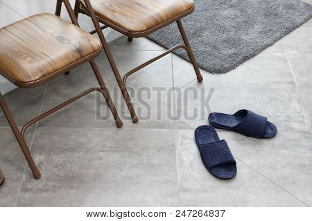 Blue Pair Of Slippers In The Entry Way Of A Home. Indoor Entrance Chairs And Slippers Of An Office.