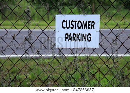 an image of customer parking sign