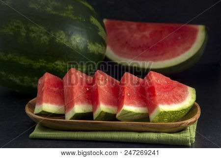 Fresh Seedless Summer Watermelon On A Slate Counter