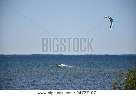 Kite Surfer In Action In The Water By The Swedish Island Oland In The Baltic Sea