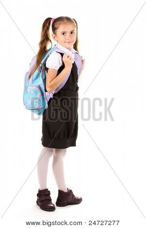 Portrait of beautiful little girl in school uniform with backpack. Isolated on white