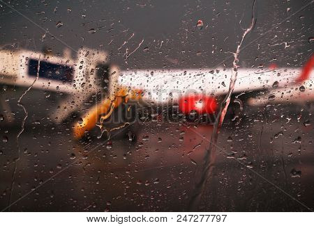 Raindrops Falling On Glass At The Airport Of Bangkok City , Don Mueng Airport Thailand  With Blur Pl