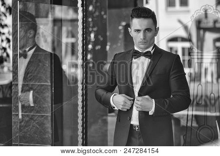 Elegant Man In A Suit. Confident Businessman. Young Man Wears Suit And Bow Tie With Confidence.