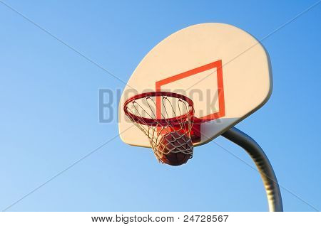 A basketball shot swishes through the net poster