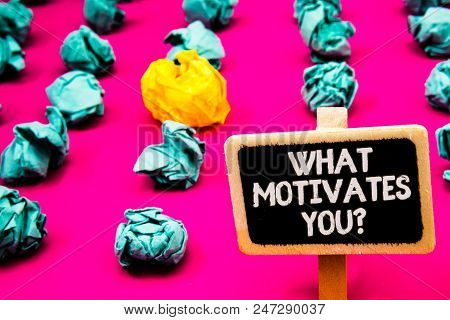Conceptual Hand Writing Showing What Motivates You Question. Business Photo Text Passion Drive Incen