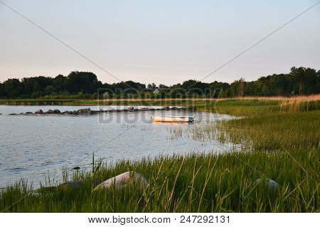 Lone Rowing Boat By The Coast In A Bay At The Swedish Island Oland