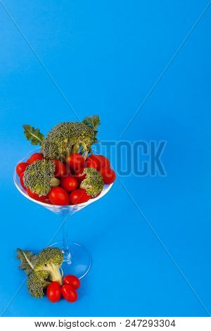 Red Sweet Cherry Tomotes Green Organic Broccoli Florets In Martini Glass Virtical Framed Lower Left